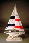 Red and White Blue Sailboat
