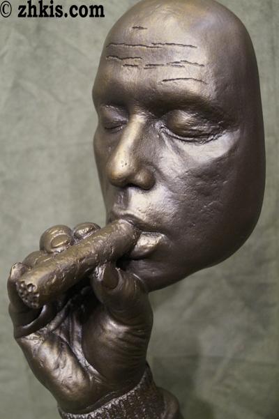 Man Smoking Cigar Statue