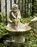 Cherub Sitting on Shell Birdbath