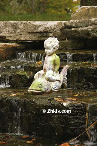 Boy riding fish garden statue for Fish garden statue