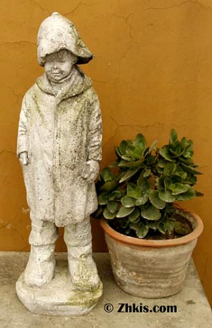 Young Boy In Raincoat Statue