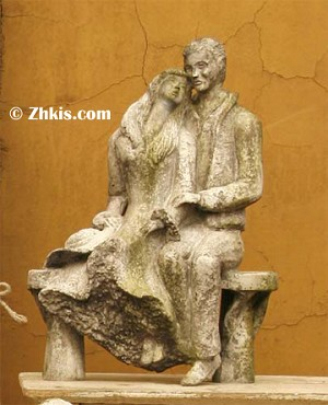 Contemporary Couple Sitting Statue