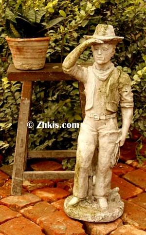 Cowboy With Hat Statue