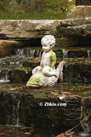 Boy Riding Fish Garden Statue